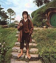 Frodo holds a hobbit pipe on the stairs cut into the hill in front of Bilbo's House, from Fellowship of the Ring, New Line Cinema