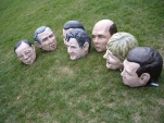 Plaster heads of 7 world leaders assembled on the grass
