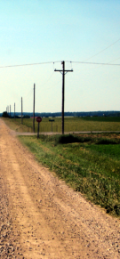 rural telephone poles along side a gravel road