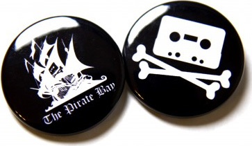 White Pirate Ship silhouette on one and A casette tape making the skull above crossbones for the other