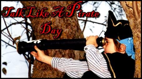 Boy in pirate gear looks through a spyglass