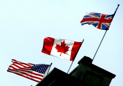 American, Canadian and British Flags fly over the Walper Hotel, Kitchener, Ontario